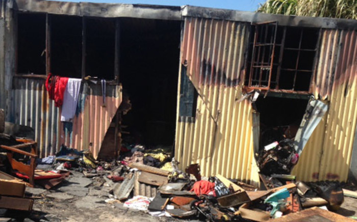 The city's Disaster Risk Management's Wilfred Solomons-Johannes says a fire ripped through the Asanda Village informal settlement in Strand yesterday destroying six shacks. Picture: Lauren Isaacs/EWN.