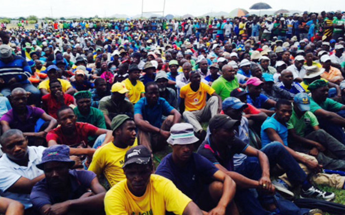 FILE: Amcu members listen to Joseph Mathunjwa ahead of the start of the union's strike on the platinum belt on 23 January 2014. Picture: Vumani Mkhize/EWN.