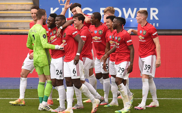 Manchester United midfielder Jesse Lingard (3R) celebrates scoring their second goal with team-mates during the English Premier League football match between Leicester City and Manchester United at King Power Stadium in Leicester, central England on 26 July 2020. Picture: AFP