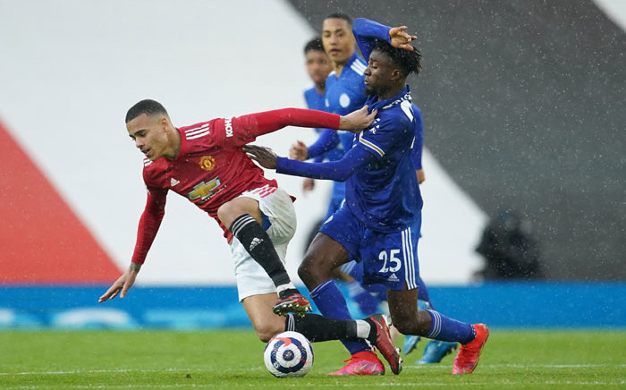 Manchester United striker Mason Greenwood (L) vies with Leicester City midfielder Wilfred Ndidi during the English Premier League football match between Manchester United and Leicester City at Old Trafford in Manchester, north west England, on 11 May 2021. Picture: Dave Thompson/AFP