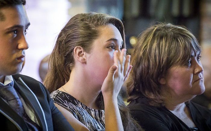 Michaela Holz, daughter of slain Warrant Officer Petrus Holz, wipes away a tear during her father's funeral at the Dutch Reformed Church in Somerset West. Holz was murdered on the N2 when he pulled over after his vehicle hit an obstruction, allegedly placed their by his killers. Picture: Thomas Holder/EWN