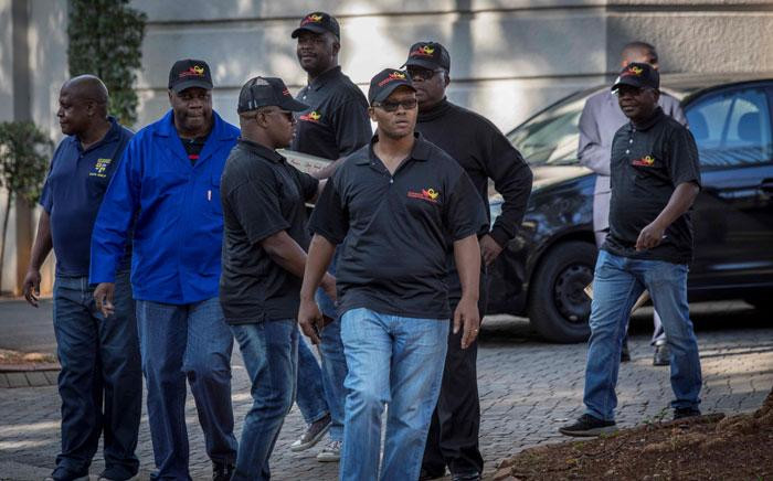 Hawks and SAPS officials at the Gupta compound in Saxonwold, Johannesburg during a raid on 14 February 2018. Picture: Thomas Holder/EWN