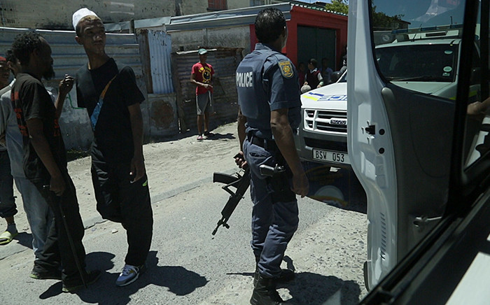 A member of the Saps stands on patrol in Manenberg. Picture: Thomas Holder/EWN