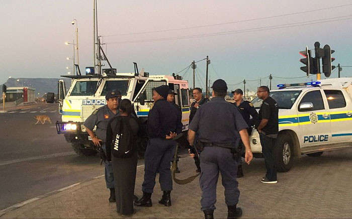 Police monitored the scene following a protest in Dunoon on Friday 8 April 2016. Picture: Monique Mortlock/EWN.