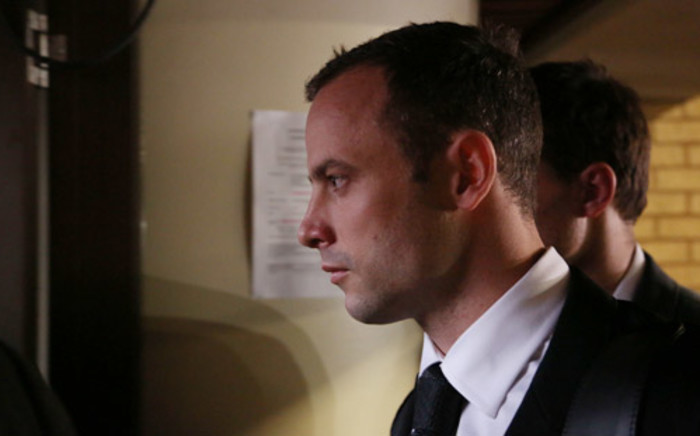 Oscar Pistorius leaves the High Court in Pretoria after the third day of his murder trial on 5 March 2014. Picture: Aletta Gardner/EWN.