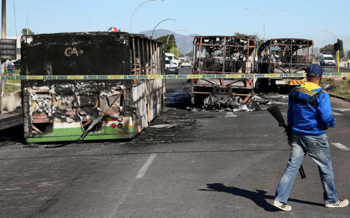 Torched Golden Arrow buses in Nyanga, Cape Town on Monday, 1 September 2014. It's believed to be related to protesting taxi drivers. Picture: Sapa