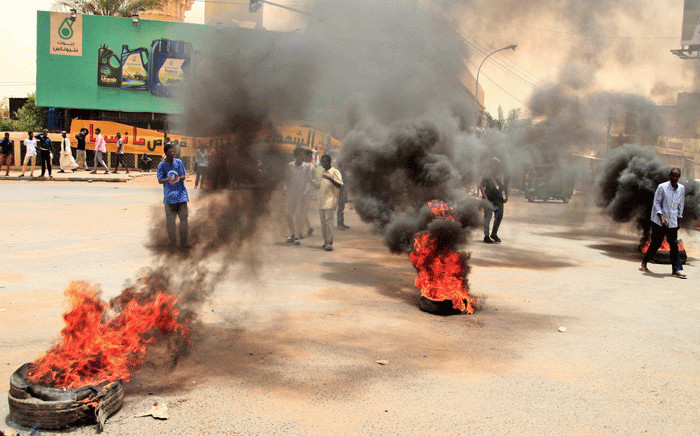 Sudanese protesters burn tyres during a demonstration in Omdurman, the capital's twin city, urging the government to step down over delayed justice and recent harsh economic reforms, on June 30, 2021. The demonstrations were triggered by growing popular discontent against a recent government and after the IMF approved $2.5 billion loan and debt relief deal Sudan that will see the country's external debt reduced by some $50 billion. Picture: Ebrahim Hadim / AFP