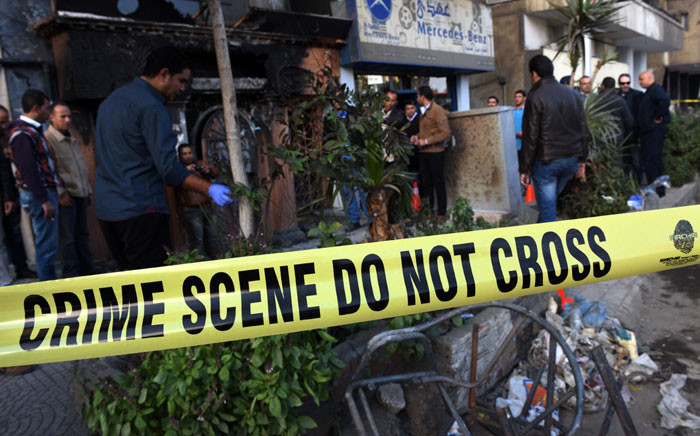 FILE: People and investigators gather at the scene of a petrol bomb attack on a Cairo disco in 4 December 2015. Picture: AFP.