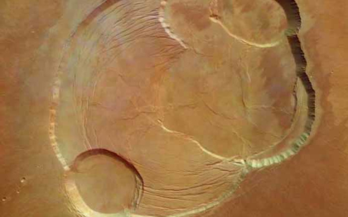 An overhead view of the caldera or summit crater region of Olympus Mons. Picture: nasa.gov.