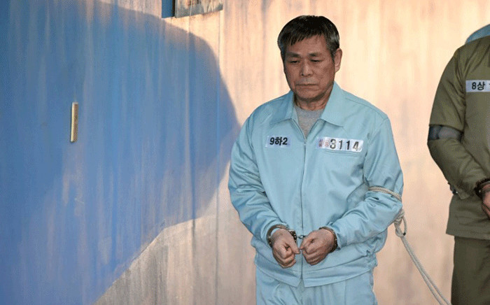South Korean pastor Lee Jaerock arrives at the Seoul Central District Court to attend his trial in Seoul on 22 November, 2018. Picture: AFP.