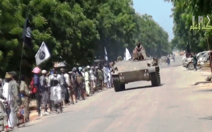 FILE: A screengrab taken on November 9, 2014 shows Boko Haram fighters parading on a tank in an unidentified town. Picture: AFP.