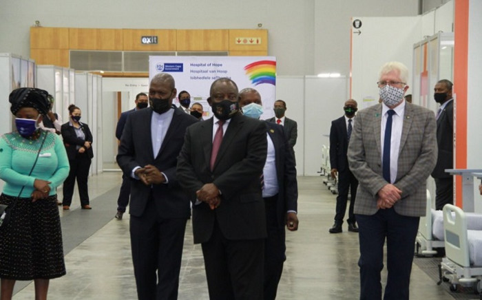 President Cyril Ramaphosais guided by Western Cape Premier Alan Winde on a tour of the province's Hospital of Hope; an 850-bed COVID-19 facility which has been established at the Cape Town International Convention Centre. Picture: @PresidencyZA/Twitter