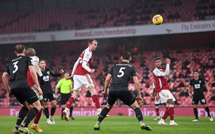 Arsenal's Rob Holding has a header at goal against Burnley in their English Premier League match on 13 December 2020. Picture: @Arsenal/Twitter