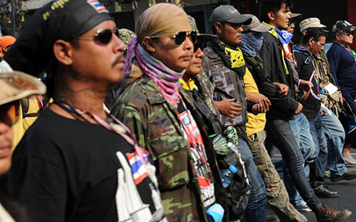 Thai anti-government protesters march towards polling stations to block their accesses in Bangkok on 26 January 2014. Picture: AFP