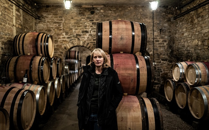 Australian wine merchant Jane Eyre poses for a photograph on January 11, 2021 in the Chateau de Bligny's cellar in Bligny-les-Beaune. Eyre has won the La Revue des Vins de France 2021 Wine Merchant of the Year award. Picture: Jeff Pachoud/AFP