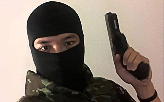 FILE: This screenshot made on 8 February 2020 from the Facebook page of Jakrapanth Thomma, a Thai soldier wanted in connection to a deadly attack in the north-eastern city of Nakhon Ratchasima, shows him holding a gun at an unknown location. Picture: AFP.