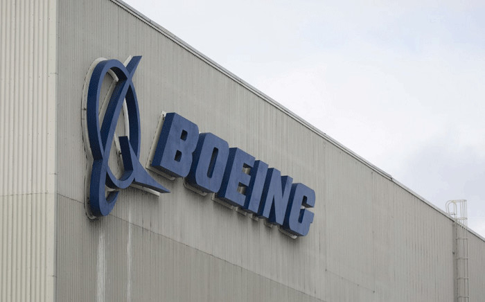 In this file photo taken on March 12, 2019 the Boeing logo is pictured at the Boeing Renton Factory in Renton, Washington. Crisis-hit Boeing faced fresh safety concerns on October 31, 2019, as the firm admitted cracks were found in up to 50 of its popular 737NG planes following worldwide inspections. Picture: AFP.