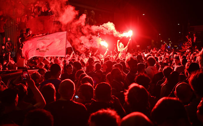 Fans celebrate Liverpool winning the Premier League title outside Anfield stadium in Liverpool, north west England on 25 June 2020, following Chelsea's 2-1 victory over Manchester City. Picture: AFP