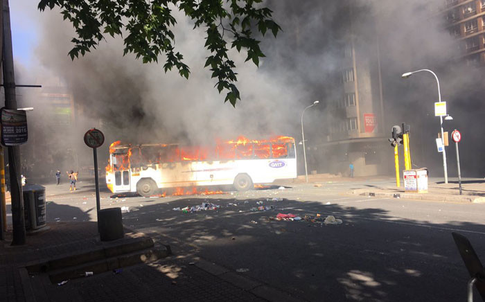 FILE: A bus has been set alight during Fess Must Fall protests as Wits students continue protesting. Picture: Clement Manyathela/EWN.