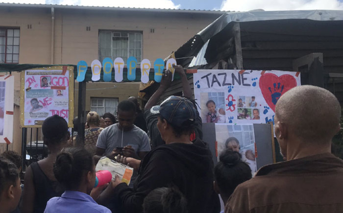 FILE: Neighbours, friends, relatives and classmates gather outside Tazne van Wyk's home in Elsies River after news of her death came to light on 20 February 2020. Picture: Lizell Persens/EWN