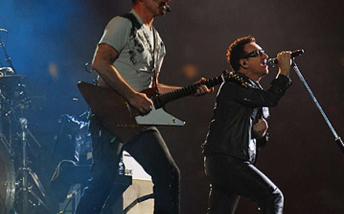 U2's The Edge (with guitar) and Bono performing at the band's 360° Tour concert at FNB Stadium on Sunday February 13 2011. Picture: Taurai Maduna/EWN.