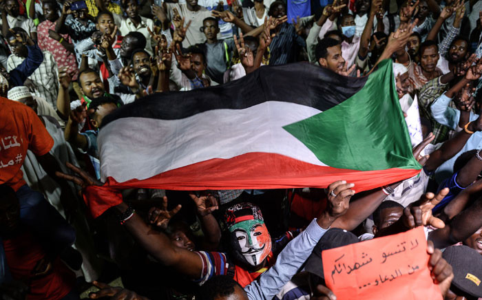 FILE: Sudanese protesters gather for a sit-in outside the military headquarters in Khartoum on 19 May 2019. Picture: AFP