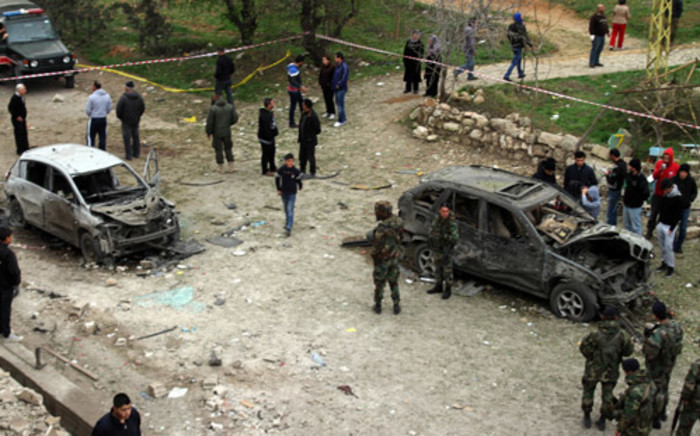 Lebanese security forces inspecting the site of a suicide car bomb attack in the village of Al-Nabi Othman, the Bekaa Valley, near the Syrian border on 17 March 2014, following a late night suicide attack. Picture: AFP.