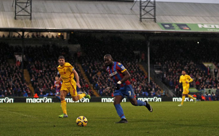 Crystal Palaces French-born Congolese midfielder Yannick Bolasie (2nd L) runs with the ball as Liverpool's English midfielder Steven Gerrard (L) closes in during the English Premier League football match between Crystal Palace and Liverpool. Picture: AFP