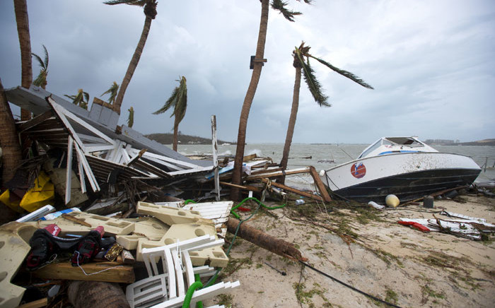 Debris and a boat washed up onto shore in Marigot, near the Bay of Nettle, on the French Collectivity of Saint Martin, after the passage of Hurricane Irma on 6 September, 2017. Picture: AFP
