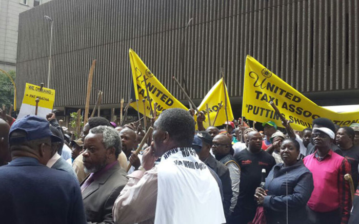 FILE: Hundreds of taxi operators making their way to office of MEC in Johannesburg CBD on 17 November 2014. Picture: Aurelie Kalenga/EWN