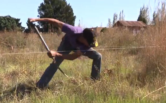 A screengrab of an Eldorado Park resident, Dawid Stevenson, preparing a piece of land where he plans to build his house, as the residents continue to illegally grab land in the area.