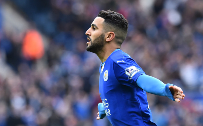 Leicester City's Algerian midfielder Riyad Mahrez celebrates scoring the opening goal during the English Premier League football match between Leicester City and Swansea at King Power Stadium in Leicester, central England on 24 April, 2016. Picture: AFP.