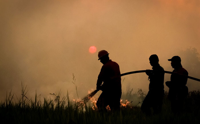 This picture taken on 22 August 2019 shows Indonesian firefighters battling a forest fire in Ogan Ilir, South Sumatra. Picture: AFP