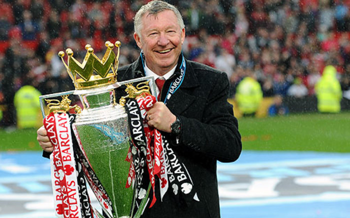 Former Manchester United manager Sir Alex Ferguson with the 2012/13 Barclays English Premier League trophy. Picture: AFP