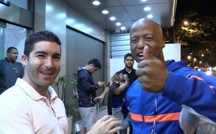Jimmy Tau is welcomed by EWN Sport Marc Lewis upon his arrival in Rio de Janeiro on 1 July 2014. Tau will be working with EWN Sport to give his analysis and predictions. Picture: Christa Eybers/EWN.