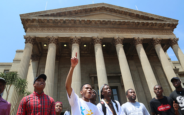 Wits University students sing and dance during a third day of protests on campus over proposed tuition fee increases on 16 October 2015. Picture: Reinart Toerien/EWN.