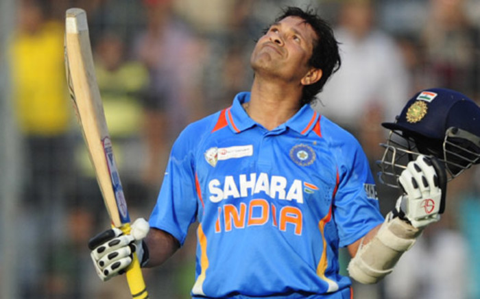 BANGLADESH, Dhaka: Indian batsman Sachin Tendulkar reacts after scoring his hundredth century during the one day international (ODI) Asia Cup cricket match between India and Bangladesh at the Sher-e-Bangla National Cricket Stadium in Dhaka on March 16, 2012.Tendulkar became the first batsman in history to score 100 international centuries, adding another milestone in his record-breaking career. Picture:AFP.