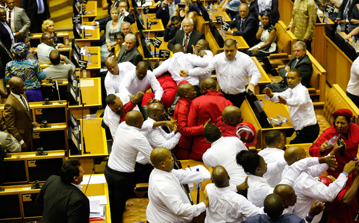 FILE: Security officials remove EFF members from the National Assembly after they disrupted President Zuma's 2017 State of the Nation Address. Picture: AFP