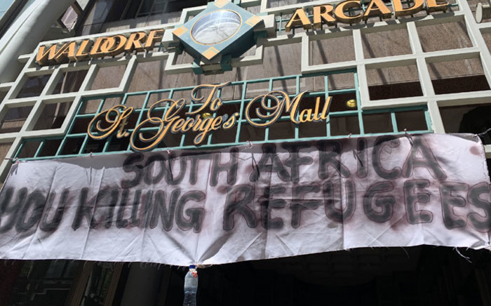 A banner outside the UN Refugee Agency in Cape Town. Picture: Kaylynn Palm/EWN