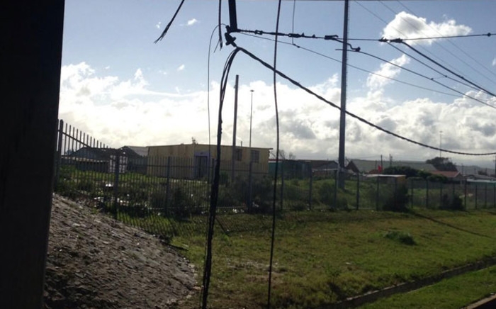 Burnt cables hang after a train was attacked with a petrol bomb in Khayelitsha on 21 August 2014. Picture: Lauren Isaacs/EWN.