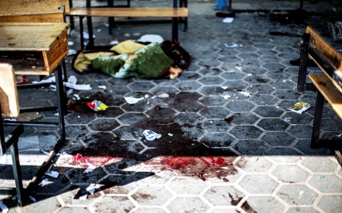 A trail of blood is seen in the courtyard of a UN School in the northern Gaza Strip after it was hit by an Israeli tank shell, 24 July 2014. At least 15 people were killed, including a baby. Picture: AFP.