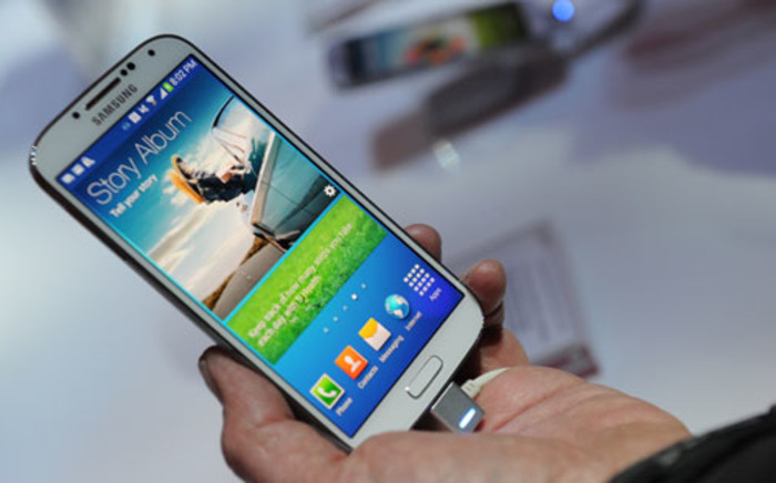 Samsung's new Galaxy S4 is seen during its unveiling on March 14, 2013 at Radio City Music Hall in New York. The slim, feature-rich Galaxy S4 was introduced as Samsung's new champion in the fiercely competitive smartphone arena, scheduled to roll out in 155 countries in late April. AFP PHOTO / Don EMMERT