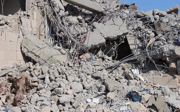 This AFPTV screen grab from a video made on 1 September 2019, shows a view of destroyed buildings in the aftermath of reported air strikes carried out by the Saudi-led military coalition against a Huthi military target in Dhamar, south of the capital Sanaa, in an attack the rebels said killed dozens of people. Picture: AFP.