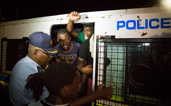 Police remove UCT protestors after they refused to leave the Bremner building on the UCT campus. Picture: Anthony Molyneaux/EWN