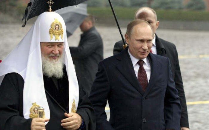 Russian President Vladimir Putin (right) walks with Russian Orthodox Church Patriarch Kirill, left, at the Red Square on 4 November, 2013. Picture: AFP.