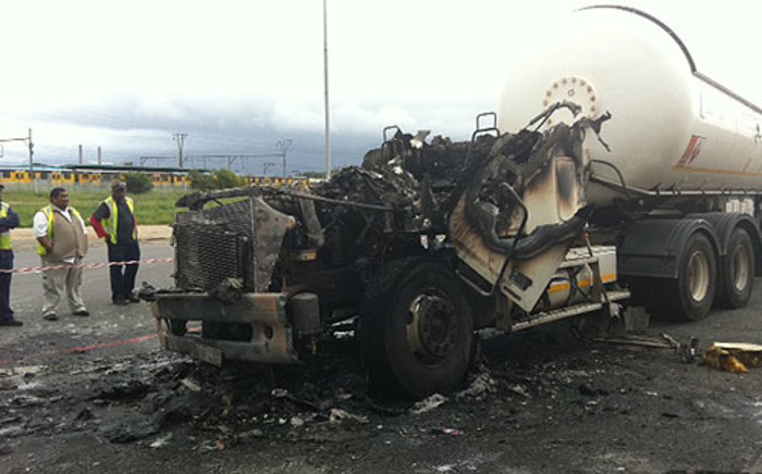 Cape Town firefighters put out the burning truck at Afrox in Epping on 3 October 2012. Picture: Malungelo Booi/EWN