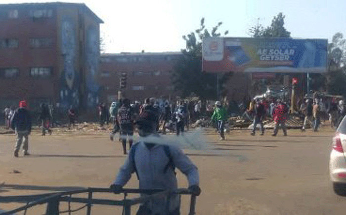 Heavy earth-moving equipment backed by police trucks demolished marketplace stalls in Harare's low-income Mbare suburb. Picture: @HonChamisa/Twitter.