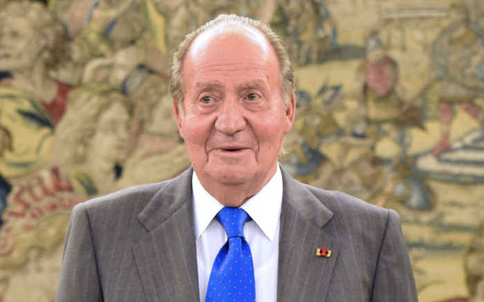 FILE: Spain's former King Juan Carlos waiting for Ecuador's President before a meeting at the Zarzuela Palace near Madrid on 24 April 2014. Picture: AFP.