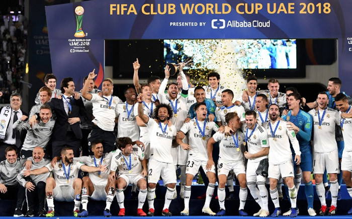 Real Madrid players and management celebrate with the trophy after winning the Club World Cup. Picture: @realmadriden/Twitter.