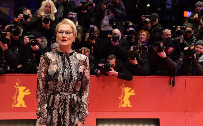 """US actress and jury president Meryl Streep poses for photographers as she arrives on the red carpet for the film """"Hail, Caesar!"""" screening as opening film of the 66th Berlinale Film Festival in Berlin on 11 February 2016. Picture: John Macdougall/AFP."""